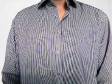 The moire-effect on a tight patterned shirt.